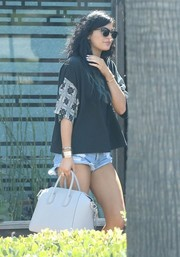 Kylie Jenner teamed a boxy tee by ASOS with distressed jean shorts for a lunch out.