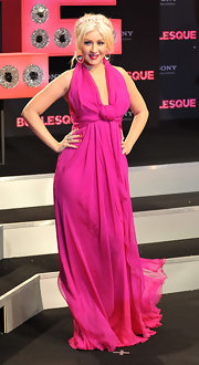 Christina is a fiery goddess in a hot pink chiffon evening dress.