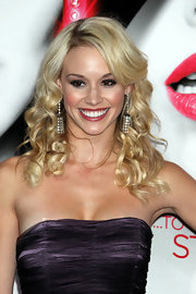 Tyne Stecklein paired her diamond chandelier earrings with small ringlet curls. Her side swept bangs completed her look.