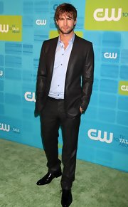 Chase Crawford paired his light blue button down shirt with a sleek black suit.