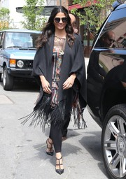 Camila Alves layered a fringed black shawl over a print dress for a day out in New York City.