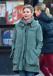 Cameron Diaz beat the winter chill with a trendy green utility jacket while out with a friend in NYC.