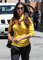 Camila Alves covered up in round sunglasses.