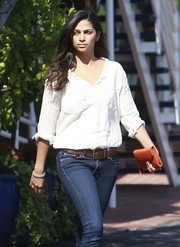 Camila Alves was spotted at Fred Segal wearing blue jeans, a brown leather belt, and a white shirt.