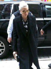 Cara Delevingne was spotted out in New York City looking cool in her gold round sunglasses.