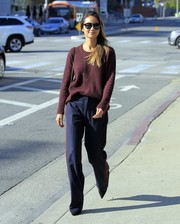 Jamie Chung sealed off her smart look with a pair of navy side-striped slacks.