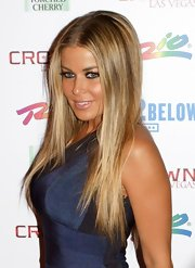Carmen Electra showed off her long center part straight locks while walking the red carpet.