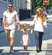 Cash Warren looked easy breezy in his pink button-down shirt and beige shorts while out on a stroll with his daughter.