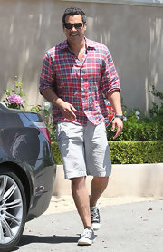 Cash Warren looked all set for summer in his plaid button-down shirt and Bermuda shorts.