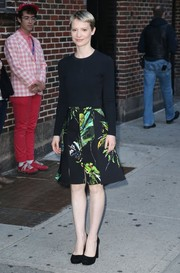 Mia Wasikowska styled her top with a retro-chic tropical-print skirt.