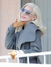 Lady Gaga looked winter-chic in camel-colored leather gloves and a gray coat.