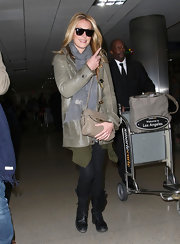 Cat Deeley traveled in black edgy combat boots.