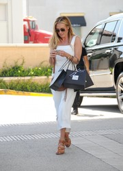 Cat Deeley went shopping at Barneys New York wearing a summery white jumpsuit.