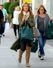 Cat Deeley tied her outfit together with a pair of beige over-the-knee boots.