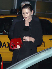 Catherine Zeta Jones added kick to her sleek black evening wear with a fire engine red clutch.