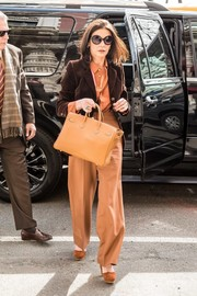 Catherine Zeta-Jones coordinated her look with a pair of ochre platform pumps.