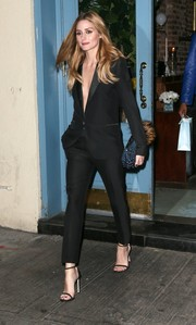 Olivia Palermo completed her flawless look with a pair of Stuart Weitzman Nudist sandals, in black.