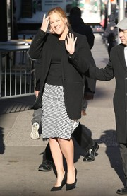 Amy Schumer teamed her jacket with a black-and-white gingham pencil skirt.
