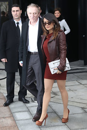 Salma Hayek gave her mini maroon dress an edge with a brown leather jacket.