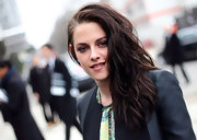 Kristen Stewart attended the Balenciaga fall 2012 fashion show wearing her hair in side-swept waves.
