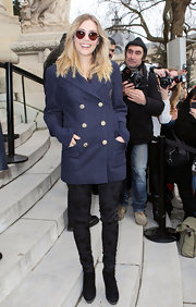 Elizabeth Olsen had a school girl vibe at the Chanel show in a navy double-breasted blazer.