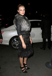 Diane Kruger topped off her fur ensemble with black suede cutout pumps.