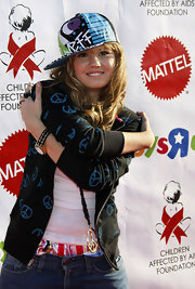 Debby Ryan had fun with her look at the 16th Annual Dream Halloween Fund raising event in a graphic print baseball cap.
