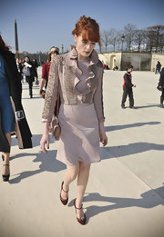 Florence wears a cropped jacket with a ruffled neckline for the Valentino fashion show in Paris.