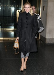 Allison Williams completed her stylish ensemble with a small, two-tone hat-box purse.