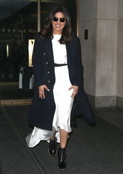 For warmth, Priyanka Chopra wore a navy Ralph Lauren wool coat with gold buttons.