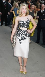 Amber Heard balanced her feminine CFDA Awards dress with a rectangular leopard print clutch.