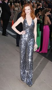 Marcia Cross teamed her standout silver sequined jumpsuit with an elegant sparkly hard case clutch.