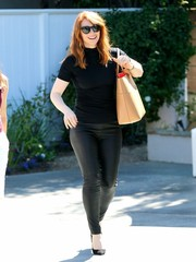 Bryce Dallas Howard left the Day of Indulgence Summer Party wearing a tight black turtleneck.