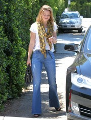 Melissa Benoist attended the Day of Indulgence Summer Party rocking the flare jeans trend.