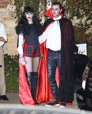 Gwen Stefani came as a sexy vampire in plaid short shorts and knee-high boots to Kate Hudson's Halloween party.
