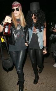 Jessica Alba was Slash's perfect doppelganger in her black leather skinnies, denim vest, and voluminous wig.