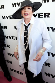 Liza Minnelli adorned herself with white pearls, including a pearl cuff at the AAMI Derby.