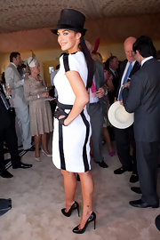 Megan Gale paired black patent leather pumps with a cocktail dress for a classic look during the AAMI Victoria Derby Day.