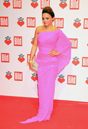 Estefania stood-out on the red carpet in Berlin, working this dramatically draped bright fuchsia number.