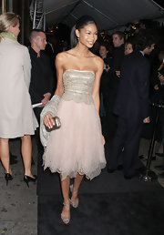 Chanel Iman wears her hair tightly pulled back in a formal ponytail.