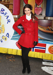 Victoria is a doll in this bright red belted wool coat at the Macy's Thanksgiving Day Parade.