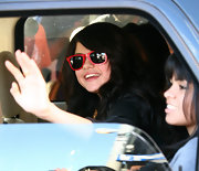 "Selena keeps her cool in a pair of bright ""Red Marble"" wayfarers."