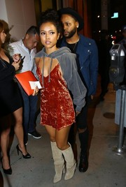 Karrueche Tran pulled her funky outfit together with a pair of knee-high suede boots.