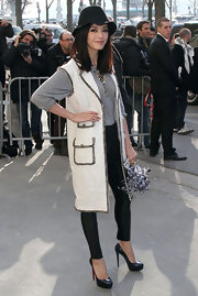 Fan dons a long tweed vest over her laid back ensemble for the Chanel fashion show in Paris.