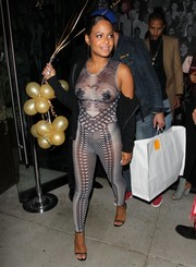 Christina Milian went racy in a sheer printed catsuit for the grand opening of Catch LA.