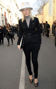 Anna goes for an equestrian feel in a black belted blazer and matching pants at the Dior fashion show in Paris.