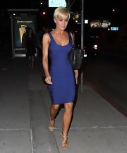 Kellie Pickler chose a purple bandage dress to show off her fit figure while out in LA.