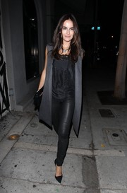 Camilla Belle paired a black silk blouse with leather skinnies for a night out at Craig's.
