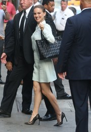 Natalie Portman styled her outfit with elegant black lace pumps by Dior.