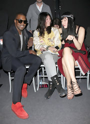 Emmanuelle Alt hung up the heels for the night and opted for a pair of embellished flat boots for the Jean Paul Gaultier show.